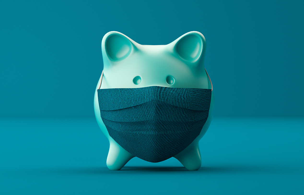 A pig money box with a facemask covering the front